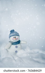 Cute snowman with cold grey and snow fall background
