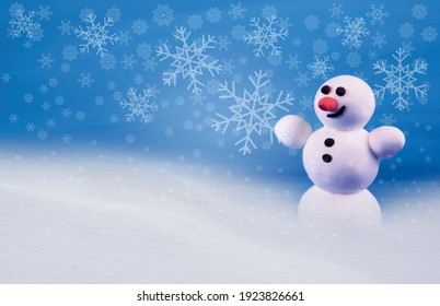 Cute snowman in a snowy landscape stock images. Winter landscape with snowman images. Happy snowman in winter scenery. Holiday blue snowy background with snowman