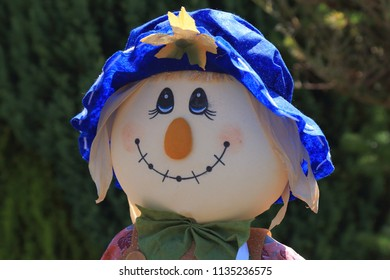 Cute straw filled boy scarecrow