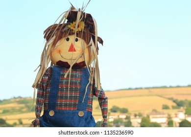 Cute straw filled boy scarecrow on a farmland in East Devon