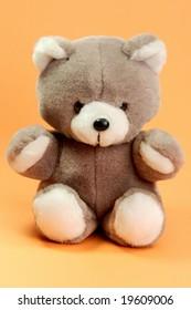 Cute stuffed animal on orange background