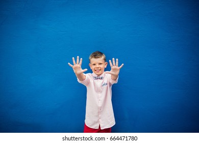 cute stylish boy raising hands smile