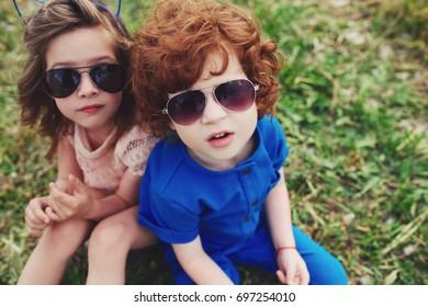 cute stylish children in summer park