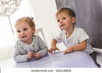 Cute stylish kids are playing in the children's room