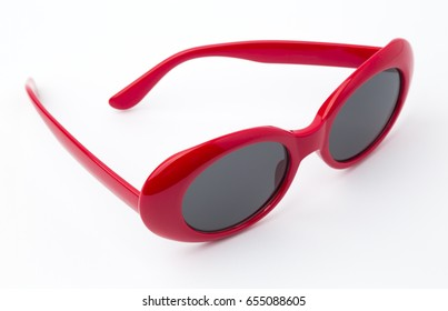cute sunglasses with red plastic frame isolated on white background