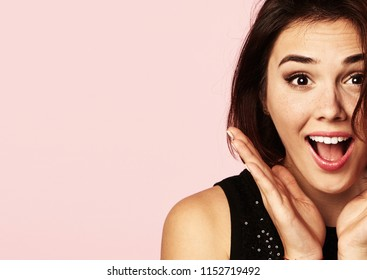 Cute surprised girl over pink background.