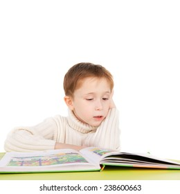 cute sweet boy reading a book