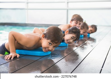 Cute swimming class at the pool at the leisure center
