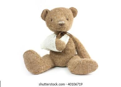 cute teddy bear with a broken arm in a sling