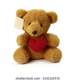 Cute Teddy Bear doll sitting and red heart symbol for lover. Isolated on white background