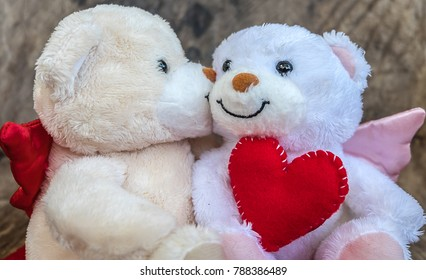 Cute teddy bear holding red heart, are loving each other happily. Valentine day concept,love,wedding concept,