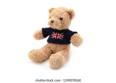 Cute teddy bear with nice clothes is isolated on a white background for designs