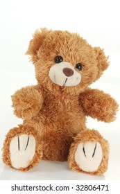 Cute teddy bear on bright background