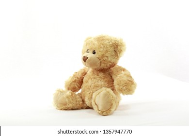 A cute teddy waiting patiently for love.