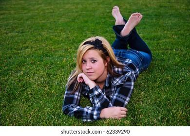 Cute teen enjoying the outdoors wearing plaid