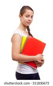Cute teen girl holding notebooks on white background