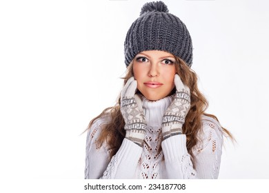 Cute teen girl in a knitted cap and sweater close-up portrait