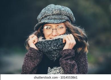Cute teen girl in modern clothes posing outdoor. Warm autumn day. Seasonal autumn and winter fashion.