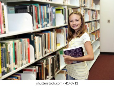 A cute teen girl at the school library.