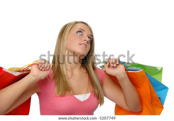Cute teen girl with shopping bags looking up