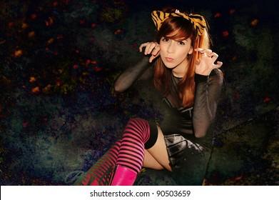 Cute teen in Halloween costume, vintage grunge added.
