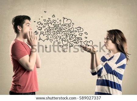 Cute Teenage Couple Blowing Kisses Hearts Stock Photo Edit Now