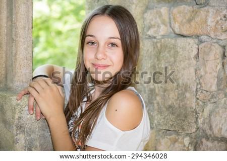 A Cute Teenage Girl Of 12 Years Old Smiling At The Camera