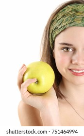 Cute teenage girl holding apple in front of white background