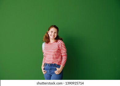 Cute teenage girl on color background