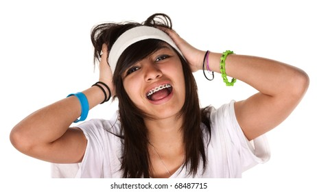Cute teen-aged girl holds her head while screaming