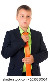 Cute teenager boy in back business suit correcting tie over white isolated background, half body, future career concept.