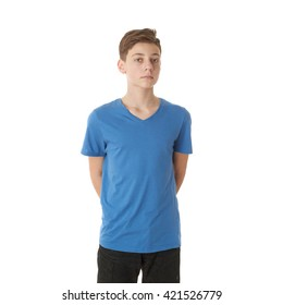 Cute teenager boy in blue T-shirt over white isolated background, half body
