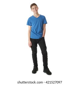 Cute teenager boy in blue T-shirt standing with hand in pocket over white isolated background full body
