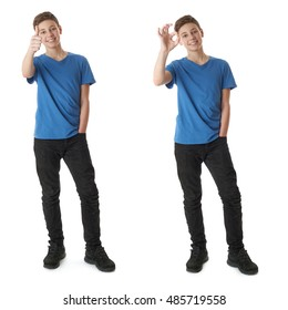 Cute teenager boy in blue T-shirt standing and showing thumb up OK sign over white isolated background full body