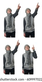 Cute teenager boy in gray sweater, hat and scarf pointing up over white isolated background, half body