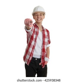 Cute teenager boy in red checkered shirt and building helmet pointing forward over white isolated background, half body, constructing concept