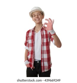 Cute teenager boy in red checkered shirt and building helmet showing OK sign over white isolated background, half body, constructing concept