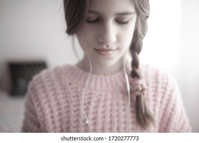 Cute teenager listening music in  her room