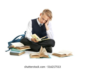 Cute teenager with textbooks on white background