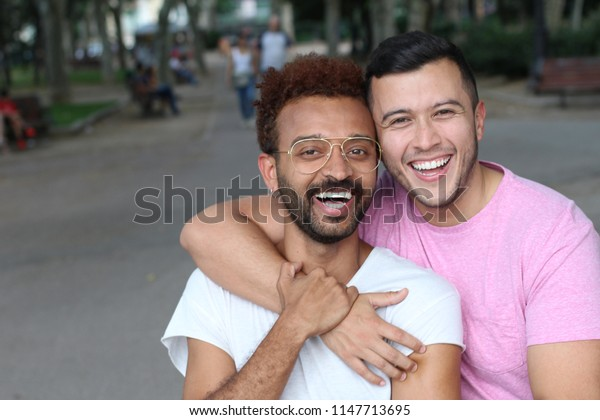 Cute and tender gay couple outdoors