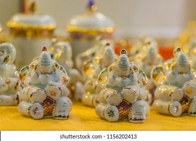 Cute Thai Benjarong elephant dolls made of ceramics. Traditional Thai elephant ceramic doll for sale as the souvenir.