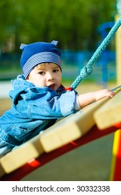 cute three year old boy playing outdoor at the Children's playground