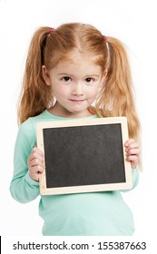 Cute three year old girl holding a small chalkboard. Isolated on white background.