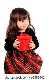 Cute three year old little girl dressed up in a fancy dress  holding a red giftbox on a white background