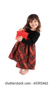 Cute three year old little girl dressed up in a fancy dress and holding a red giftbox smiling and standing barefoot on a white background