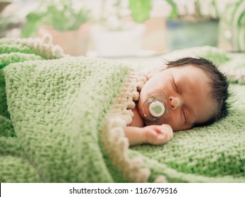 Cute tiny kid napping peacefully in his bad