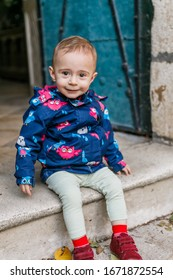 cute toddler in autumn outfits outside in the garden