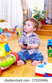 cute toddler baby playing with toys