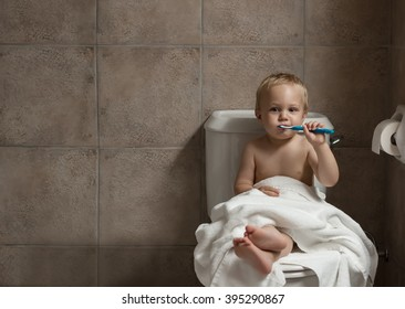 70f22d77a1 Cute toddler boy brushing his teeth after having a bath. Boy after evening  before sleep