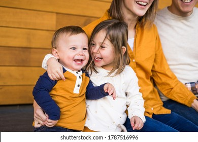 Cute toddler boy and sister giggle together